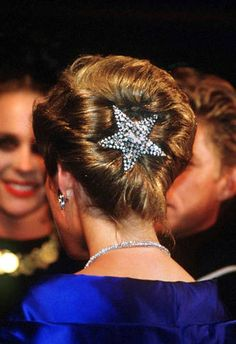 Princess Diana wore a paste diamante star (by Butler and Wilson) in her hair when she attended a 1988 fashion show at the Opera House in Sydney, Australia.
