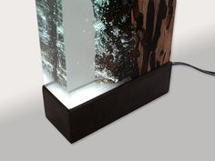 Water Bright is a fragment Venician wood and resin. Light of variable intensity reveals underwater air bubbles inside the resin as the sun in Venice canals