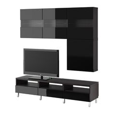 Shop At IKEA For A Large TV Stand Or Entertainment Center To Serve As A Hub  For All Of Your Media And Consoles.