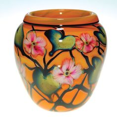 """Handsome Charles Lotton vase aartistically layered with variegated pink """"Multi flora"""" flowers and green floiage clinging onto blackened vines over a bright Mandarian orange backdrop.Signed Mr. Lotton 2001 Humler & Nolan 