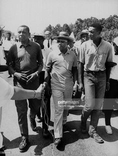 Civil rights leaders Floyd B. McKissick (fore, L), Dr. Martin Luther King Jr. (C) and Stokely Carmichael marching through Mississippi to encourage voter registration.