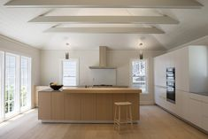 A kitchen with cathedral ceilings and shiplap paneling in San Francisco's Filbert Cottages, reenvisioned by Buttrick; seeOn the Market: The Historic Filbert Cottages in San Francisco's Russian Hill for a look.