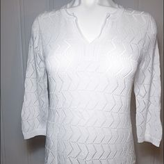 """Make Offer - Jones New York White Sweater - NWT Jones New York White Sweater - New With Tag. Gorgeous snow white tunic sweater! Made of 99% cotton and 1% other fibers...hand wash. Very stretchy! Measurements done laying flat without stretching: 21"""" across bust line from armpit to armpit, 28"""" in length and 20"""" sleeves. MSRP is $89. No trades but feel free to make an offer or ask for bundle pricing. Jones New York Sweaters V-Necks"""