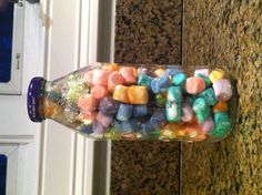 It's super easy! Get a bottle (I used a Nantucket Nectar one). Then you get food coloring and water put it in a small bowl and soak marshmallows in it take them out wait till they dry stick them in the bottle and TADA!