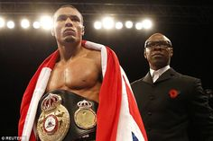 Chris Eubank Jr stands with his father after his win at the Sheffield Arena on Saturday ni...