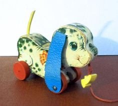 Vintage 1960s Fisher Price Playful Pup Pull Toy 626 by VintageSams, $30.00  I used to have one of these way back when...