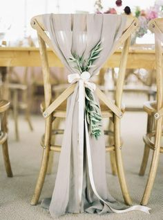 Gray color themed wedding reception ideas. Drape dressing your chairs in gray.