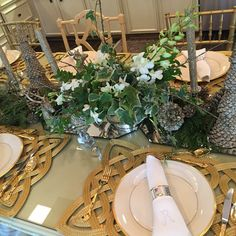 Elegant gold and silver tablescape with fresh green and white centerpiece for the holidays...