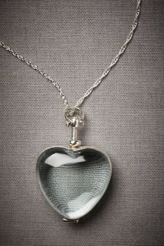 clear glass heart locket - this is too neat - put some pretty tiny flowers in it or your baby's lock of hair.