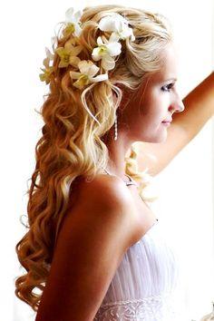 Beach Wedding Hairstyles 20 breezy beach wedding hairstyles Beach Brides Long Soft Down Curls Bridal Hair Ideas Toni Kami Wedding Hairstyles With White Orchids