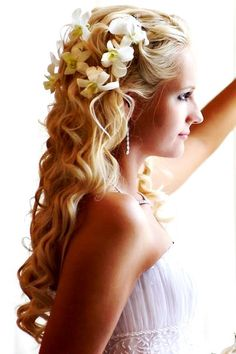 Beach Brides long soft down curls bridal hair ideas Toni Kami Wedding Hairstyles with white orchids wedding