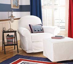 Love the striped walls and non-tacky chair/ottoman!    Nautical Nursery | Pottery Barn Kids