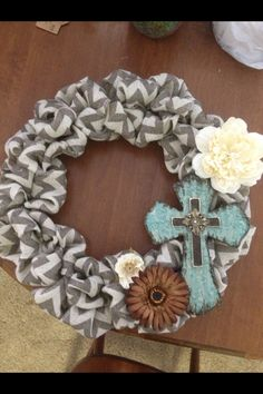Chevron Burlap Wreath with turquoise cross and accent flowers.