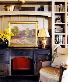 A plein air painting sits on top of a rare 1930's Monterey Colonial sideboard in the bookshelf niche. Perfect place to randomly grab a book to peruse. From Madeline Stuart.