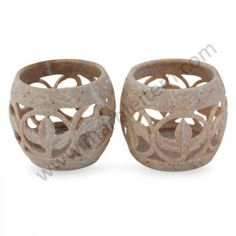 A symbol of optimism and of life itself fig leaves poise on spiral stems. Gulam Rasool is a master at traditional jali or openwork carving. Working in soapstone he crafts a beautiful pair of candleholders for the romantic glow of tea lights.