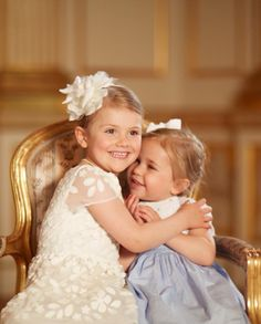 """My sister and I are blessed as mothers with two sweet little girls who adore each other!"" - Princess Madeleine on Facebook. The photos of cousins, Princess Estelle and Princess Leonore, were taken after the christening of Prince Oscar on May 27th, 2016."