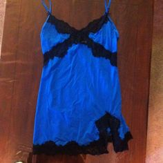 Brilliant blue stretch silk slip with lace detail Super comfy stretch silk, mesmerizing jewel blue color and sexy black lace detail- incredibly irresistible. In terrific shape- only selling because it doesn't fit anymore. Victoria's Secret Intimates & Sleepwear Chemises & Slips