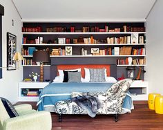 Bookshelves over bed {La Dolce Vita: Colorful and Eclectic in Madrid}