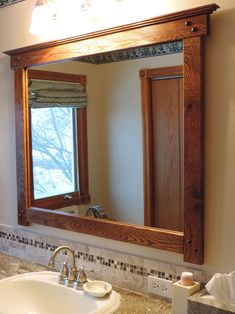 Mission style bathroom mirror I custom made from salvaged flooring to finish the remodel. Bathroom Mirror Makeover, Bathroom Mirror Cabinet, Mirror Cabinets, Bathroom Wall Decor, Bathroom Interior Design, Bathroom Styling, Mirror Vanity, Bathroom Ideas, Bathroom Furniture