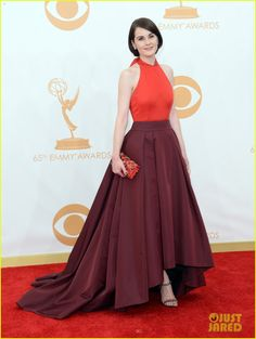 Michelle Dockery in a Prada two-tone gown in ruby red duchesse satin and burgundy silk radzmire
