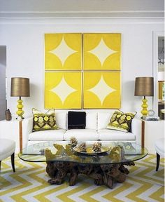 love this yellow coordinated living room! the wall art reminds me of the Steelers
