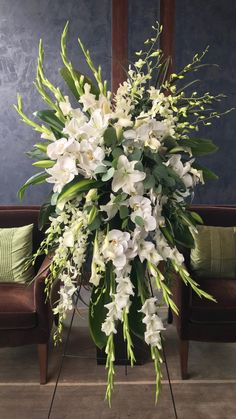 Standing sprays for funerals and memorials really make a beautiful statement. Orchids, Lilies and Gladiolus never looked so good together.