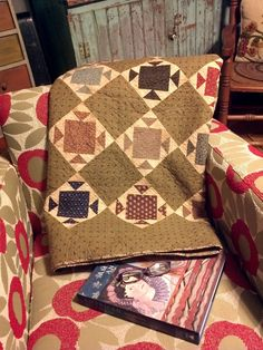 """my """"first"""" quilt finished that is just for ME! i love how lovely it looks on my new chairs, ready to curl up tonight and read a good book...."""