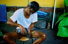 Street cobbler in Chinatown, Singapore