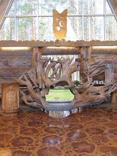 Paateri the church altar is a huge rhizome. Made by Eva Ryynänen. -  Paaterin kirkon alttarina on valtava juurakko