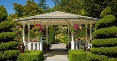 This gazebo is surrounded by all variety of hedges and shrubs. This is the perfect gazebo for enjoying the result of the hard work that has gone into the garden. Modern Landscape Design, Modern Landscaping, Contemporary Landscape, Backyard Landscaping, Backyard Ideas, Backyard Waterfalls, Walkway Ideas, Gazebo Ideas, Wooden Gazebo