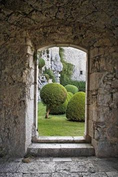 This stone doorway is a perfect frame for the garden