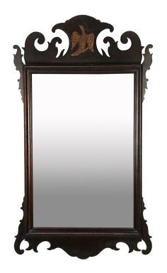 A CHIPPENDALE STYLE MAHOGANY MIRROR WITH GILT EAGLE : Lot 159