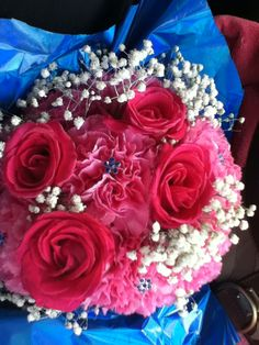 Pink roses, carnations and babies breath