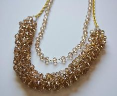 Make a sparkly statement and add the perfect amount bling to an holiday ensemble with this stunning homemade crystal necklace.