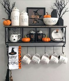 Super cute rae dunn Halloween set up!