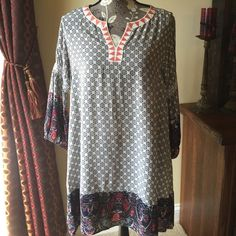 Host Pick 4/4 Boho Chic tunic dress NWT Casual Cool Host pick 4/4 NWT Boho Chic mixed print tunic dress.  This is a Re-posh. Bought from awesome seller but doesn't fit . Super cute swingy trapeze mini dress/tunic, paisley pattern, embroidered Aztec print v neck collar, shorter in front. 3/4 sleeves with smocked rows of elastic above elbow, roomy fit. Cotton/poly blend. Never worn, just tried on. Size medium. Selling at price I paid. Umgee Dresses