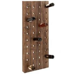 Wood wine rack with weathered details.Product: Wine rack Construction Material: Wood Color: Natural Features: Can hold up to 40 bottles of wine Dimensions: 57 H x 21 W x 4 D Note: Not recommended for outdoor use Cleaning and Care: Wipe with dry cloth Wine Bottle Rack, Bottle Wall, Wine Bottles, Wine Decanter, Empty Bottles, Wine Glass, Wood Wine Racks, Wine Rack Wall, Wine Wall