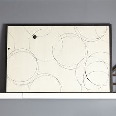 Abstract circle art over dresser