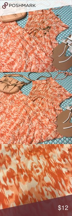 Orange halter maxi with braided straps Flowing orange and cream maxi. When tied it comes to a point under the neck which is REALLY cute, has braided halter. I Paired with a Vince Camuto cross body and white thing sandals. Sandals also available in the closet! Bundle 3 items and save 15%. Dresses Maxi