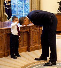 A little black boy asked Obama if he could touch his hair to see if it felt like his... (Heartwarming story behind the picture and how the image has become a West Wing favorite)