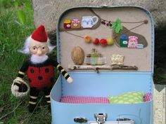 What a cute little gnome house. love all the items in the kitchen larder.. cute pots of jam.. yum! Such a cute little tea party.  I would love some tea. What a