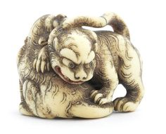An ivory netsuke of a tiger and tigress By Hoshinsai, Edo, 19th century