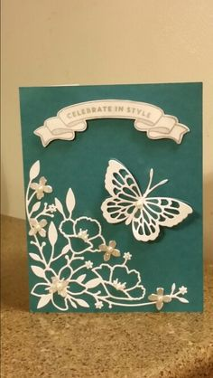 Poppystamps Theo and Whidbey Butterfly dies, Memory Box Wildflower Corner die, Mama Elephant Bloomsies stamp set (banner and sentiment) and matching die, Stampin' Up! Island Indigo and Whisper White card stock, Island Indigo and Encore ! Silver ink, Basic Pearl Jewels, and Jolee silver and pearl flower sticker embellishments were used to create this birthday card.