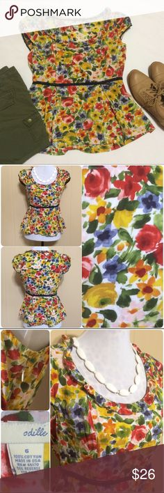 Anthropologie Peplum Blouse Colorful, vibrant blouse by Odille for Anthropologie features watercolor floral pattern, adorable peplum style, side zip, ruffled neckline & a cute ribbon where the fitted portion meets the peplum. Super flattering, perfect for work or play! Beautiful display of colors: red, green, yellow & blue on white background. Tag says 6, but it fits much more like a 4 so I'm listing as such. 100% cotton material, and made in the USA. Anthropologie Tops Blouses