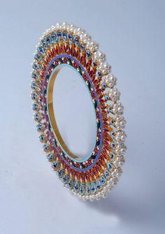 Beautiful Pearl Bangdis by Suranas Jewelove. http://www.jewelove.in/collections/kundan-meena-jewelry/bangles-bracelets
