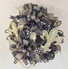 Hoping you'll love this... Saints Wreath, Black and Gold Decor, Fleur De Lis, New Orleans Wreath http://decoexchange.myshopify.com/products/saints-wreath-black-and-gold-decor-fleur-de-lis-new-orleans-wreath-1?utm_campaign=crowdfire&utm_content=crowdfire&utm_medium=social&utm_source=pinterest