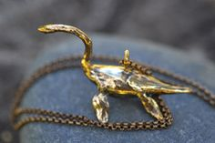 Bronze Nessie necklace from Atlantis Vintage. 180usd (the pinterest price tag covered his face!)