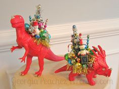 What happens when a dinosaur meets a can of red paint and a glue gun? Love her whimsy Christmas Projects, Winter Christmas, Vintage Christmas, Christmas Holidays, Christmas Ornaments, Xmas, Holiday Fun, Holiday Crafts, Retro Christmas Decorations
