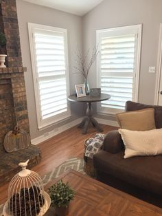 World market table, Clearview shutters. Rug from Wes elm pillows pottery barn. Essentials for living room Traditions window decor Dallas