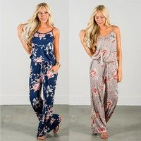 High Quality Bring on sunny days in utter comfort! This radiant floral print jumpsuit with an elast